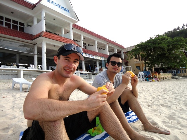eating mangoes on the beach